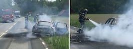 Bil fattade eld på väg – två brännskadade