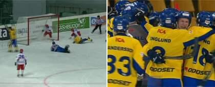 Daniel Mossberg bryter sig in framför det ryska målet och avgör med sitt 6-5-mål i den andra förlängningskvarten. Foto: SVT