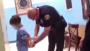 8-åringen sätts i handfängsel – kritik mot polisen efter videon