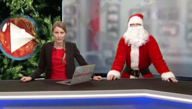 Här överraskar tomten Expressens programledare i studion
