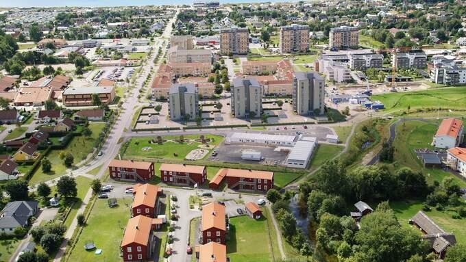 De tre höghusen mitt i bilden byggs i sex, sju och åtta våningar och ska enligt Skanskas planer se ut så här när de är färdiga. Foto: Skanska