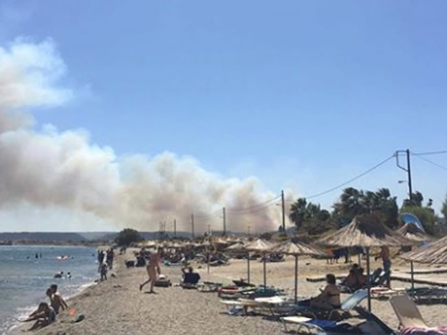 Röken började synas från stranden.