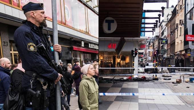 En polis vaktar vid Drottninggatan dagen efter dådet. Foto: Kenta JÖNSSON/Bildbyrån